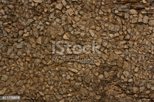 istock Wall made of stones with cement binder. 511775819