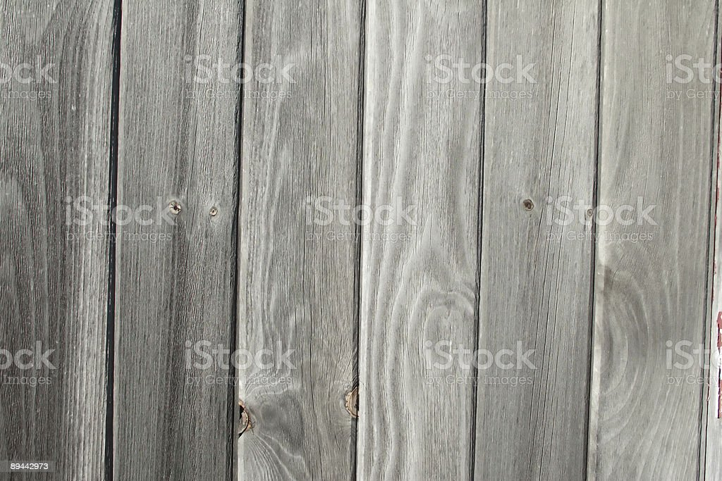 A wall made of wood grain is part of an old barn. royalty-free stock photo