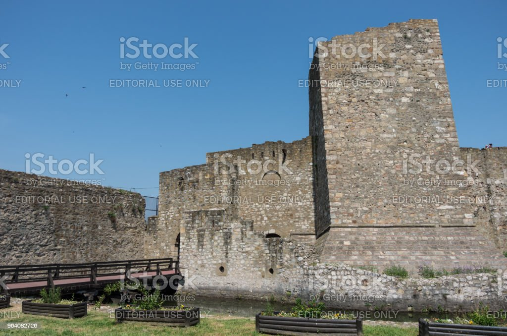 Wall, moat, towers and entrance gate of  Smederevo Fortress is a medieval fortified city in Smederevo, Serbia - Royalty-free Abstract Stock Photo