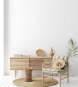 istock Wall mock up in white simple interior with wooden furniture, Scandi-Boho style 1199960436