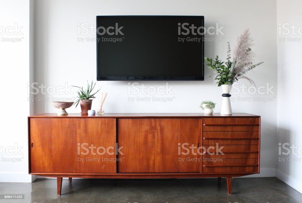 Wall mounted TV in Mid Century Modern Furnished Apartment stock photo