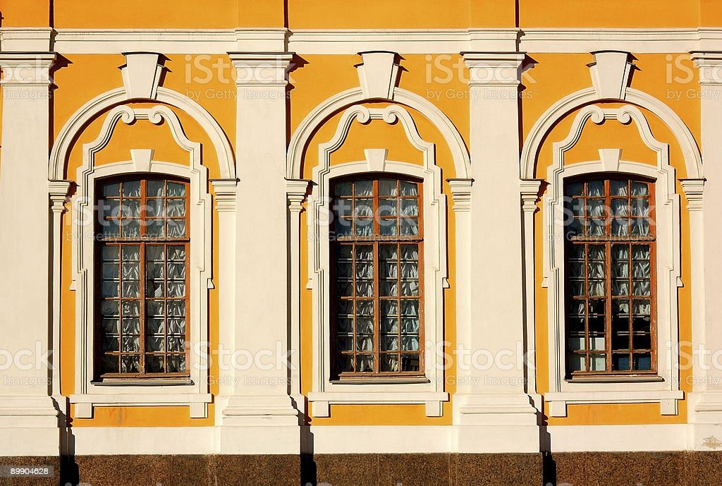 Wall of age-old building. Three windows. royalty-free stock photo