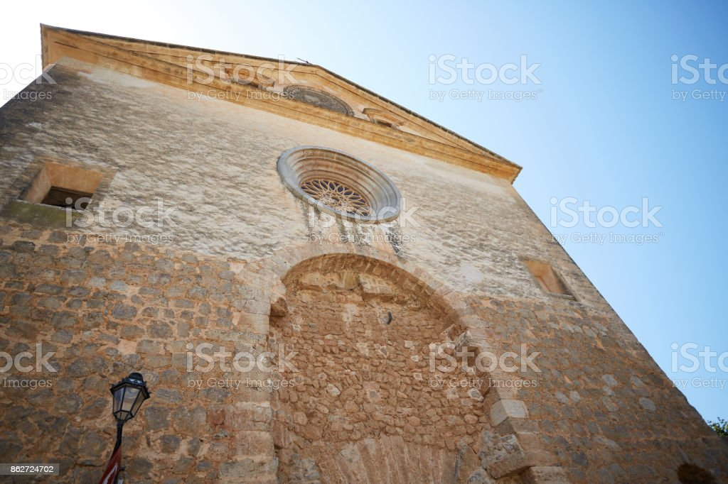Wall of beautiful Gothic building in Valldemossa on Majorca. stock photo