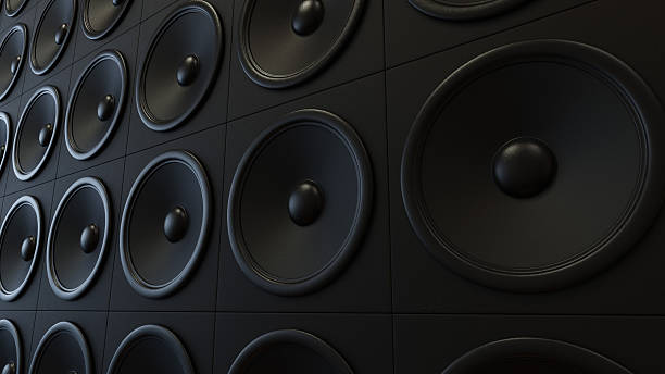 Wall of Classy Black Amplifiers stock photo