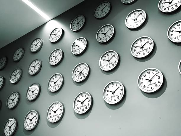 Wall of clocks for world cities and time zones Many clocks on a wall for cities around the world time zone stock pictures, royalty-free photos & images