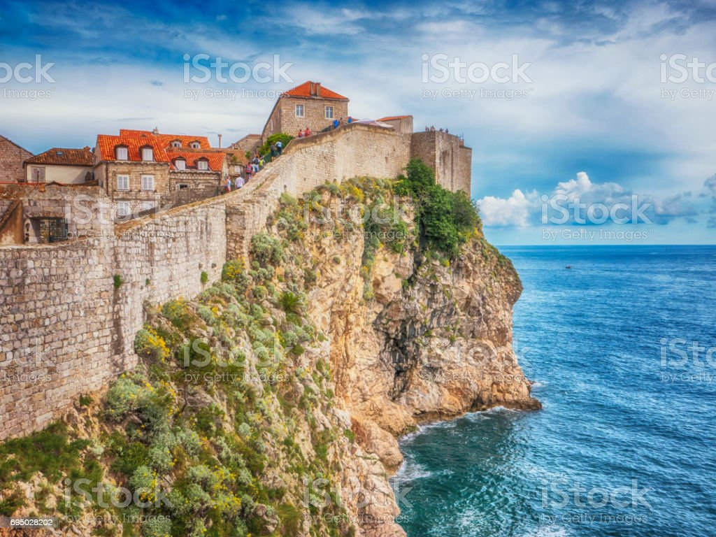 Wall of Dubrovnik's Old City next to the Adriatic Sea. stock photo