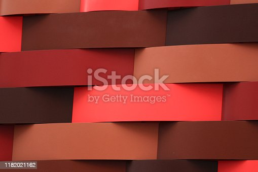 926309124istockphoto Wall of geometric pattern characterized by red gradation 1182021162