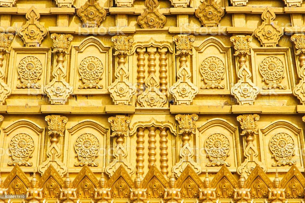 Wall of Golden Bodhgaya models in Thailand. stock photo