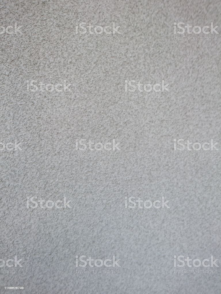 Wall of gray plaster for exterior work in construction. Background...
