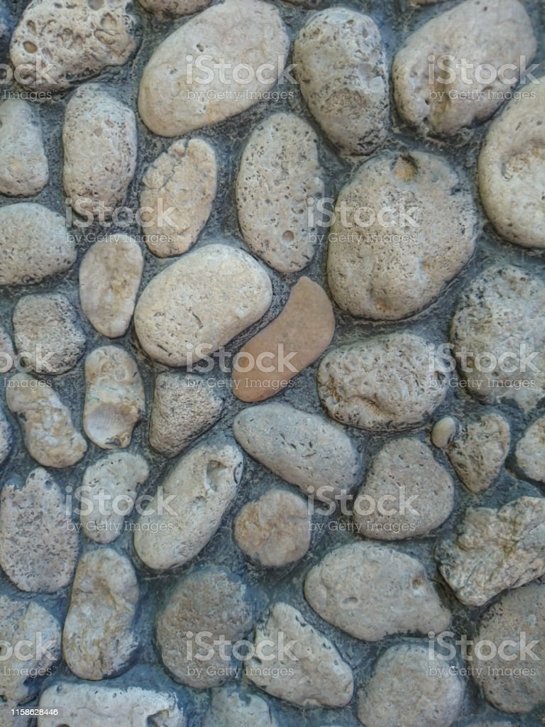 Wall of gray stone for exterior work in construction. Background image