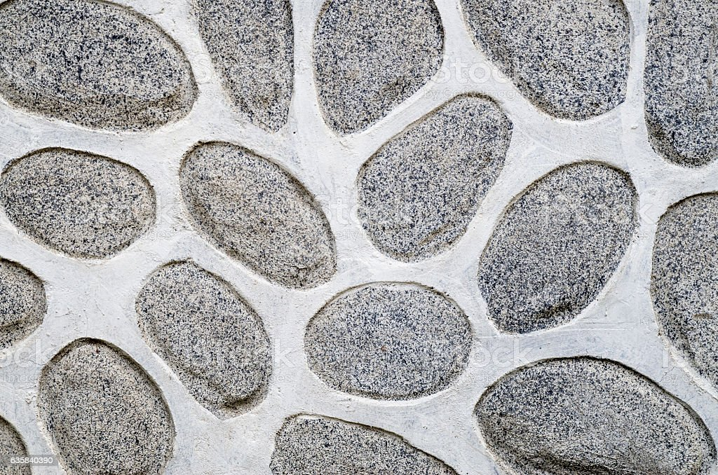 Wall of large rounded boulders with white joints stock photo