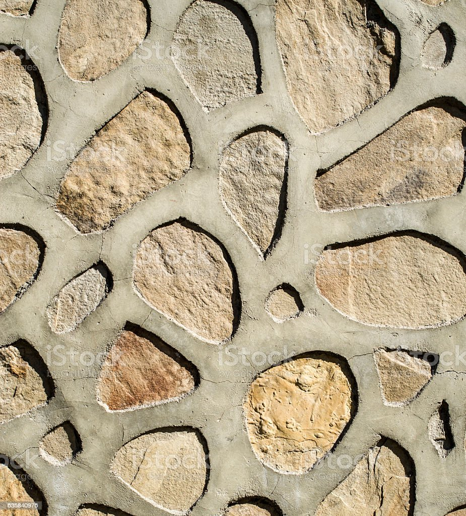 Wall of large rounded boulders with wide joints stock photo