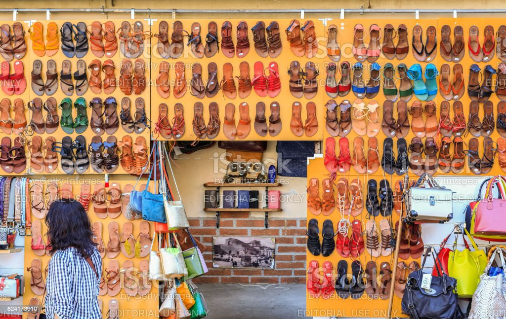 A wall of leather sandals on display at the San Lorenzo market, a popular outdoor market for tourists in Florence stock photo