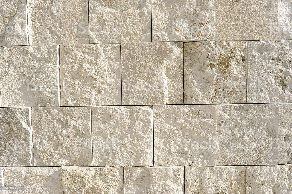 Wall of limestone blocks stock photo