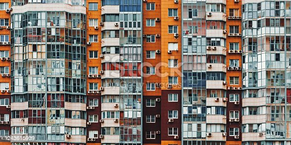 Wall Of Multistory Residential Building With Many Windows, front view texture background