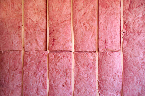 wall of pink insulation stock photo