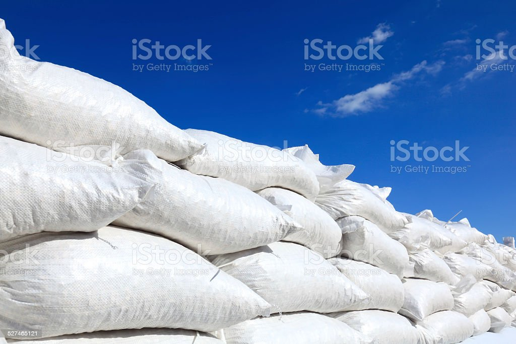 Wall of sand bags stock photo