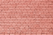A wall of small red bricks. The texture of the brickwork. Blank background.