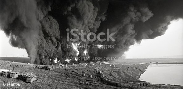 Ufa, Russia - July 12, 1969: Firemen at the fire-fighting operations training uptown Ufa extinguish the wall of fire. The exercise was conducted on the basis of ignition of oil in the pit. In extinguishing were involved forces of the fire Department of the city district of Ufa.