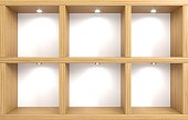 3D illustration. Modern wooden wardrobe or empty shelves with niches in a minimalist style . Interior white room of the store. The furniture and lighting. Background for banner