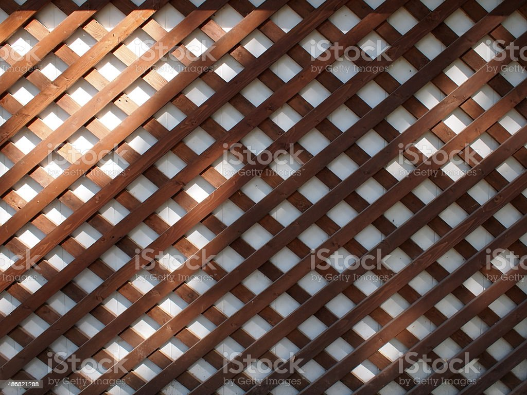 Wall of the building covered wooden planks crosswise stock photo