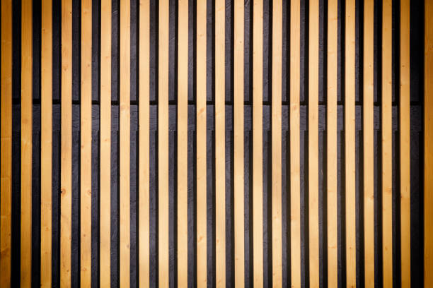 wall of thin wooden slats. vertical parallel plates. background with vignette. - estore imagens e fotografias de stock