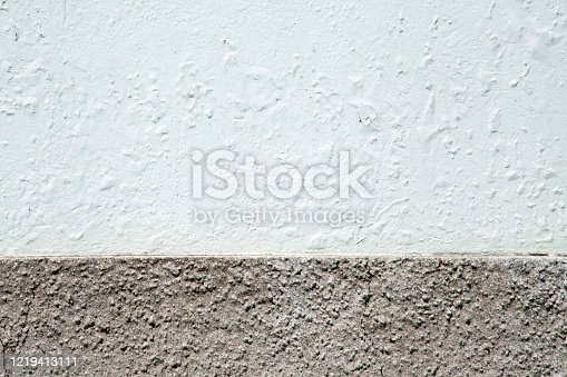 Wall painted white and grey, both available for copy space purposes. Galicia, spain.