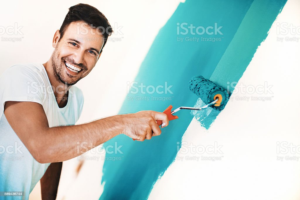 Wall painting is fun. stock photo