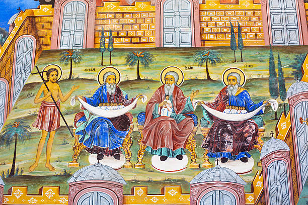 Wall painting  of Abraham, Isaac, Jacob at Rila Monastery, Bulgaria stock photo