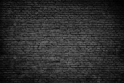 Old dark brick stones wall background