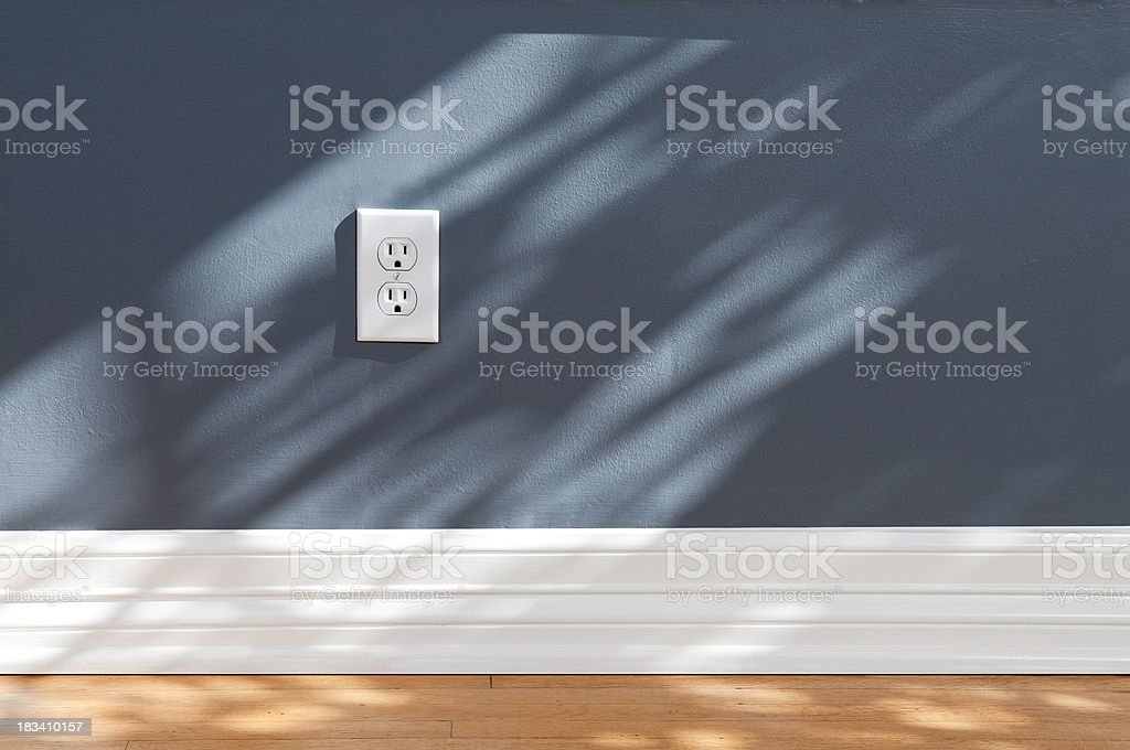 Wall Plug In Empty Room stock photo