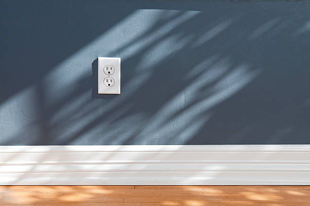 Wall Plug In Empty Room Wall plug in empty room with wood flooring.Take a look at our lightbox's of other related images. electric plug stock pictures, royalty-free photos & images