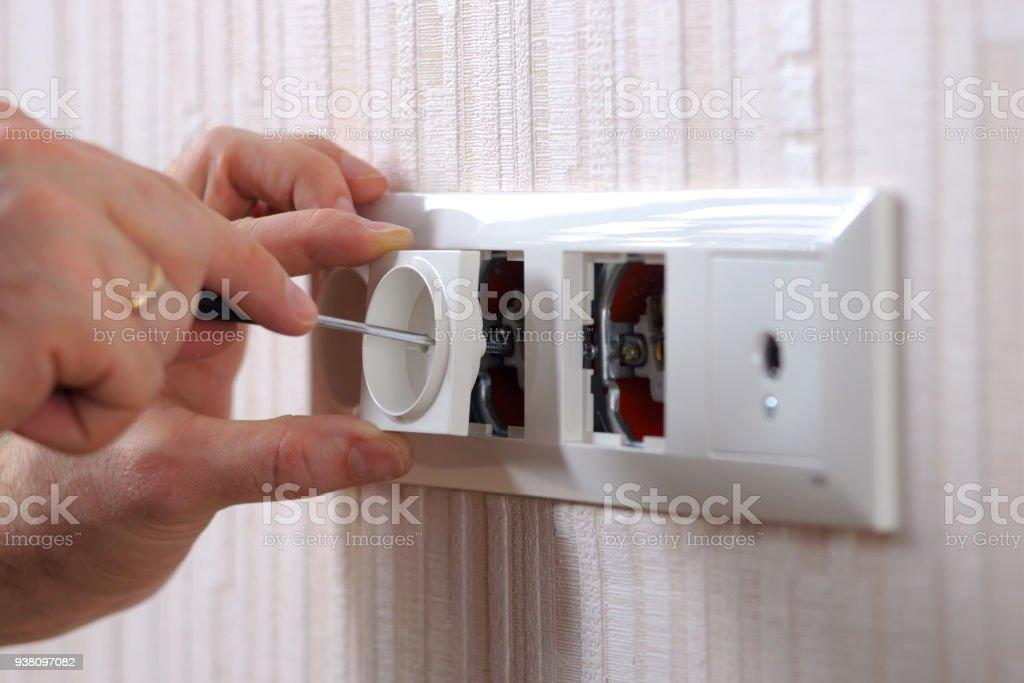 Wall power sockets installation stock photo