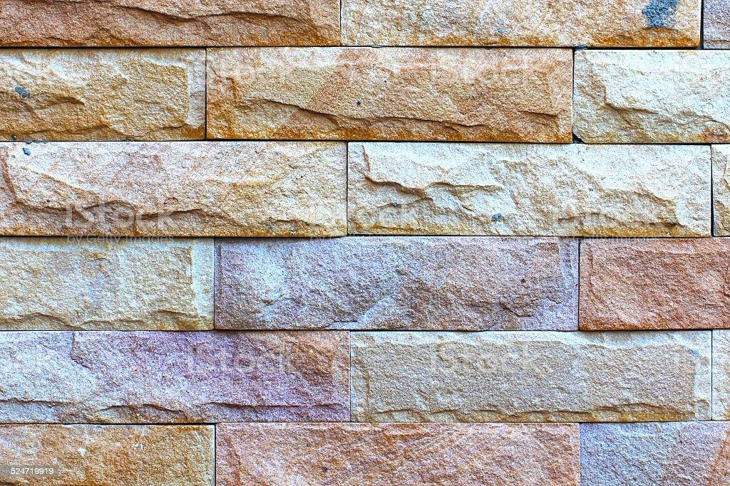 Muro di mattoni di pietra pastello con piastrelle in pietra texture