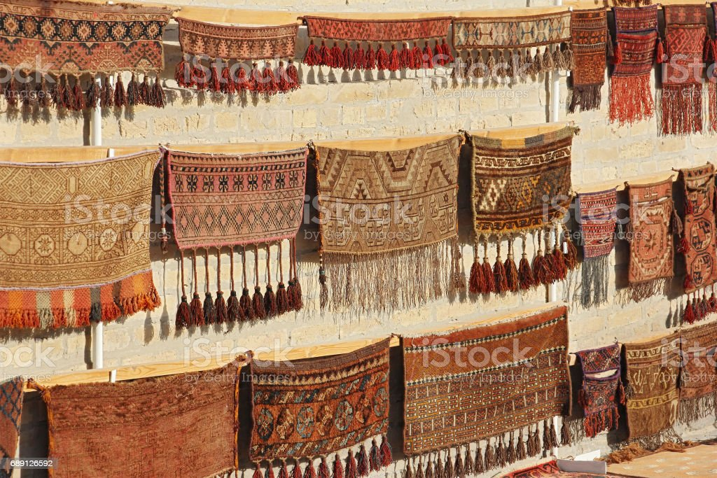 wall showcase with old traditional carpets stock photo