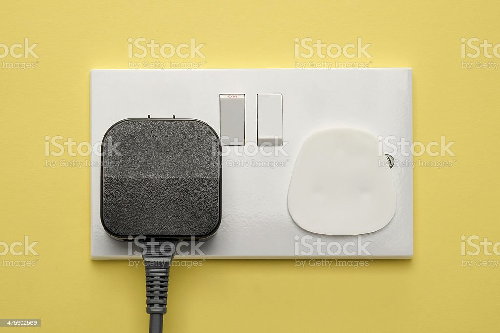 Wall socket with child safety cap stock photo