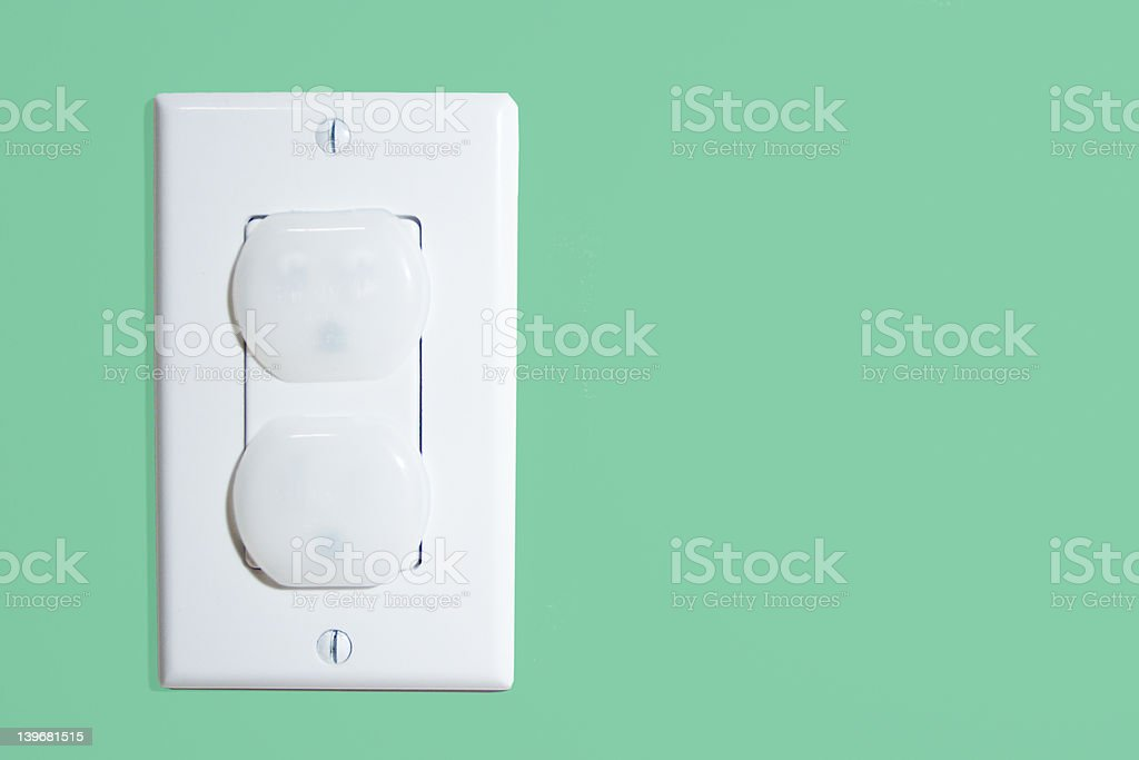 wall socket with security caps stock photo