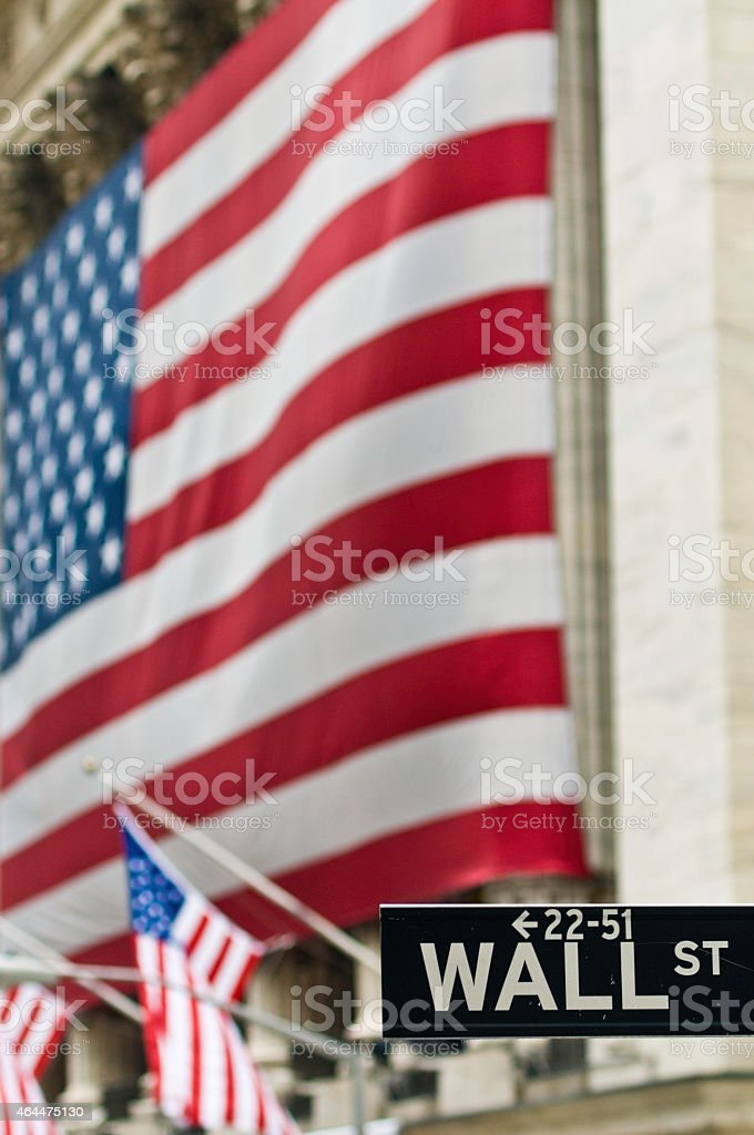 Wall St sign in front of Stars Stripes New York stock photo