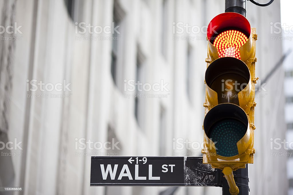 Wall street and red traffic  light royalty-free stock photo