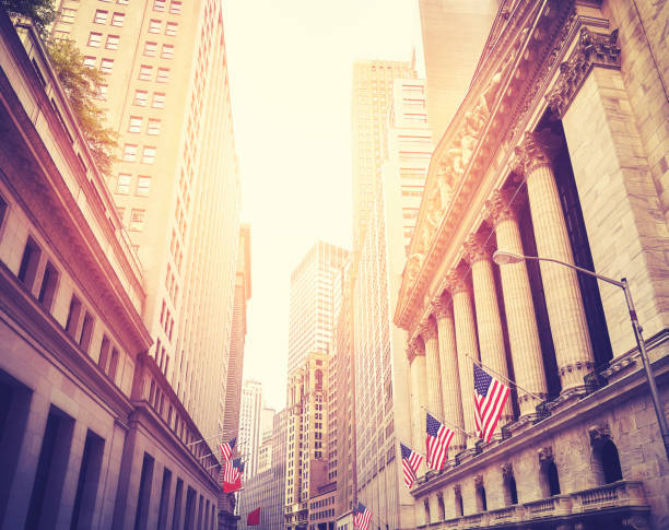 Wall Street in New York City at sunset, USA. stock photo