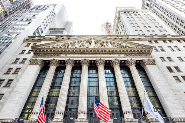 wall street, nyse stock exchange building entrance in nyc manhattan lower financial district downtown, column architecture, american flags - new york stock exchange stock pictures, royalty-free photos & images