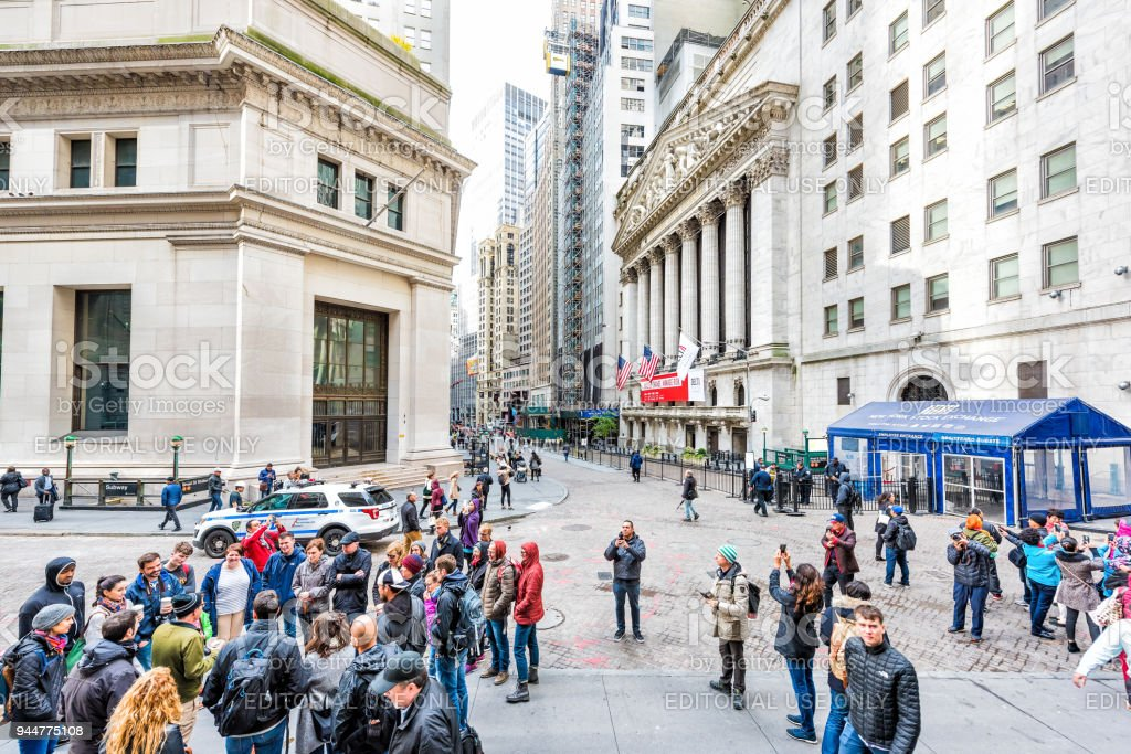 wall street nyse stock exchange buildings in nyc manhattan lower rh istockphoto com NYSE Market Holidays 2014 Stock Market Ticker
