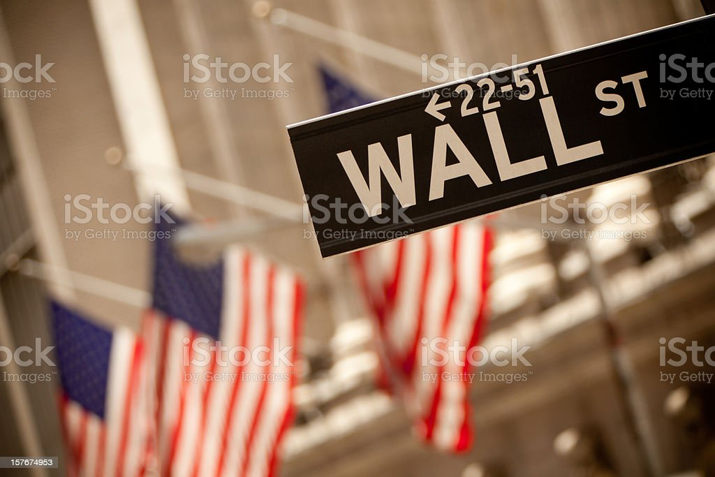 Wall Street sign and American flags royalty-free stock photo