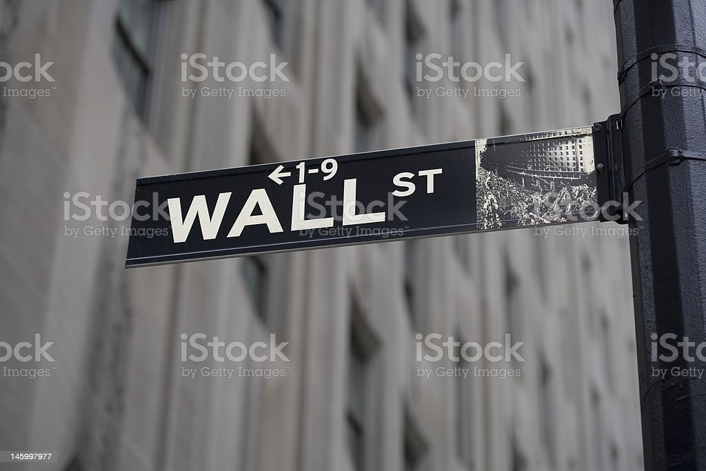 Wall Street Sign and Gray Building royalty-free stock photo