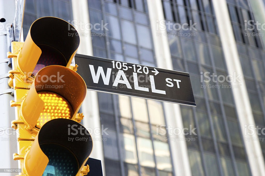 Wall Street Sign and yellow traffic light, New York stock photo