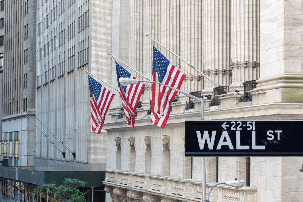 Wall street sign in New York City with New York Stock Exchange background. stock photo