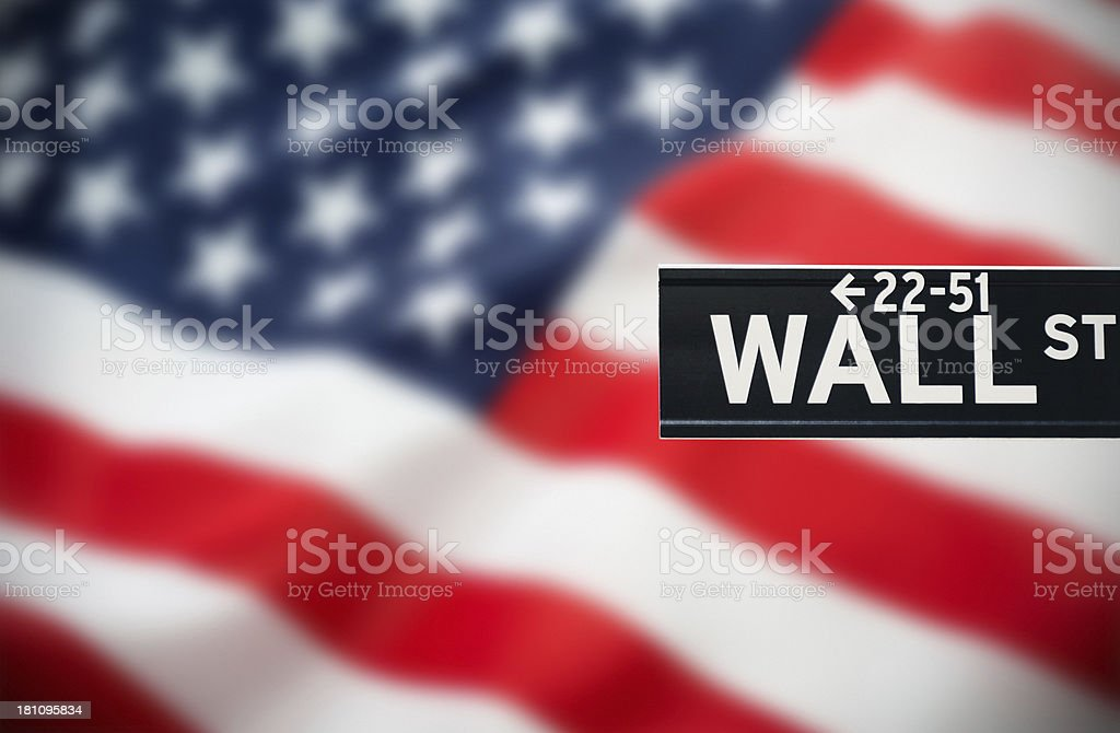 wall street sign on us flag stock photo