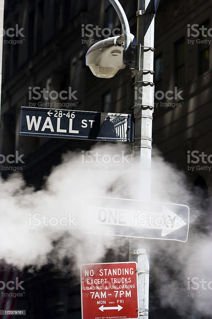 Wall Street sign surrounded by steam royalty-free stock photo