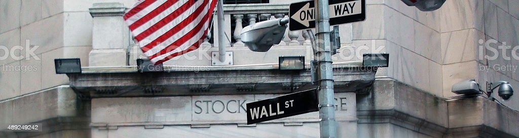Wall Street Sign With US Flag In New York City stock photo