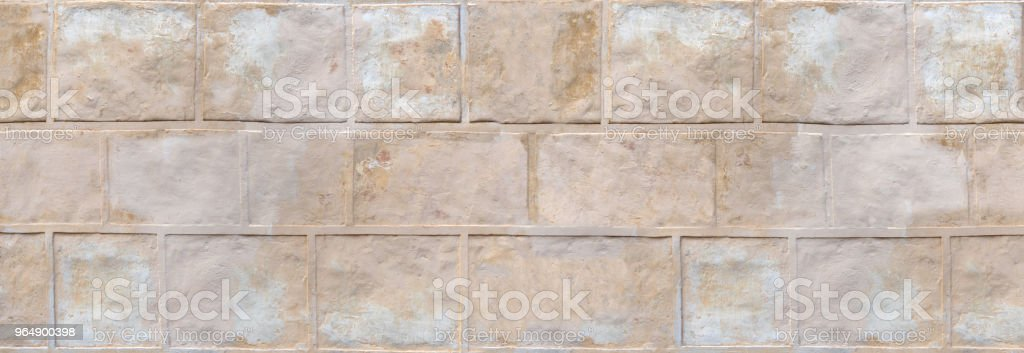Wall structure - old plastered imitation of stones royalty-free stock photo